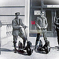 Postal Workers On Scooters by Tina M Wenger