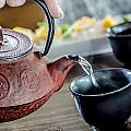 Pouring Japanese Tea by Irene  Theriau