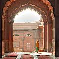 Praying At The Jama Masjid Mosque - Old Delhi by Luciano Mortula