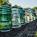 Pretty Glass Insulators All In A Row by Deborah Smolinske