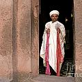Priest At Ancient Rock Hewn Churches Of Lalibela Ethiopia by Jacek Malipan