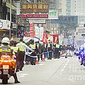 Protesters March Against Hong Kong Leader by Tuimages