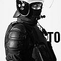 Psni Officer In Ninja Riot Geat On Crumlin Road At Ardoyne Shops Belfast 12th July by Joe Fox