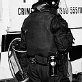 Psni Officer With Riot Gear On Crumlin Road At Ardoyne Shops Belfast 12th July by Joe Fox