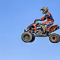 Quad Flying Through The Air by Geraldine Scull