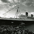 Queen Elizabeth Ship In Harbor By Barney Stein by Retro Images Archive