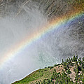 Rainbow From Spray Of Lower Yellowstone Falls Against Yellowstone Canyon Wall-wyoming  by Ruth Hager