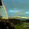 Rainbow In The Swiss Alps by Susanne Van Hulst