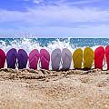 Rainbow Of Flip Flops On The Beach by Teri Virbickis