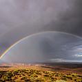Rainbow Over Desert by Michael J Bauer