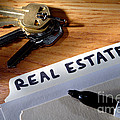 Real Estate File Folder With Marker And House Keys by Olivier Le Queinec
