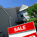 Real Estate Sold Sign And Townhouse by Olivier Le Queinec