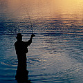 Rear View Of Fly-fisherman Silhouetted by Panoramic Images