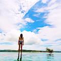 Rear View Of Woman In Bikini Standing by Konstantin Trubavin