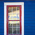 Red And White Window In Blue Wall by Lynn Hansen