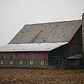 Red Barn With Medieval Silo  by Jim Nance