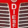 Red Bumper On Vehicle Labeled Diesel by Peter Zoeller