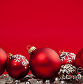 Red Christmas baubles and decorations by Elena Elisseeva