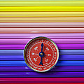 Red Compass On Rolls Of Colored Pencils by Garry Gay