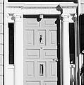 Red Georgian Door With Brass Letterbox Door Knob And Knocker In Dublin by Joe Fox