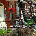 Red Geraniums Verdun Winding Staircases Hanging Flower Basket Montreal Porch Scene Carole Spandau by Carole Spandau