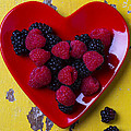 Red Heart Dish And Raspberries by Garry Gay