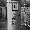 red old historic post pillar box manufactured by Handyside of Derby and London with Edward the seventh crown E Rex and VII symbols by Joe Fox