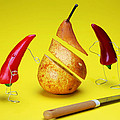 Red Peppers Sliced A Pear by Paul Ge