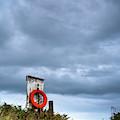 Red Ring Life Preserver Hanging by John Short