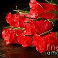 Red Roses On Wood Floor by Simon Bratt Photography LRPS