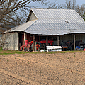 Red Tractor In A Tin Roofed Shed by Paulette B Wright
