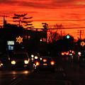 Red Winter Sunset Over Long Island Suburbs by John Telfer
