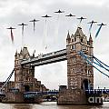 Reds Over Tower Bridge by J Biggadike
