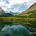 Reflection At Glacier National Park by Denise Lilly