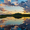 Reflections On The Water by Ismo Raisanen