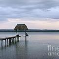 Relaxing On The Pier  Lake Peten Itza Guatemala by John  Mitchell