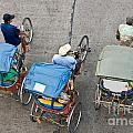 Rickshaw Driver - Bangkok by Luciano Mortula