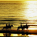 Rider Silhouettes Against The Sea by Mountain Dreams