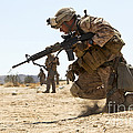 Rifleman Kneels To The Ground While by Stocktrek Images