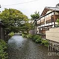 River And Houses In Kyoto Japan by Jacek Malipan