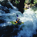 River Kayaking Over Waterfall, Crested by Adam Clark