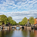 River View Of Amsterdam In The Netherlands by Artur Bogacki
