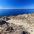 rocky coast in San Pietro island by Antonio Scarpi