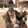 Rodeo Gunslinger With Saloon Girls Sepia by Sally Rockefeller