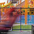 Rollercoasters At Amusement Park by Alex Grichenko