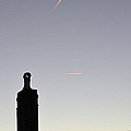 Rooftop Contrails In The Sky by James Potts