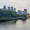 Rowing On The Schuylkill Riverwith Philadelphia Cityscape In Vie by Bill Cannon