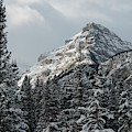 Rugged Mountain Peak With Snow by Keith Levit