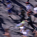 Runners Along Street In A Marathon Blurred And Abstract by Jim Corwin