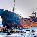Rusty Old Shipwreck Aground  On Rocky Reef by Stephan Pietzko